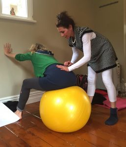 give birth on their backs-using a ball during labor